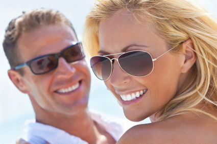 Woman and man with great smiles thanks to dental bonding - Bradshaw Family Dental